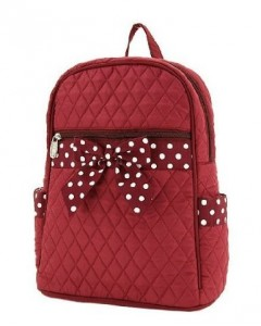 Red quilted bag with polka dot ribbon