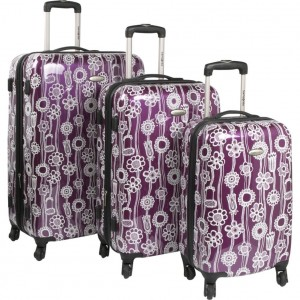 Purple Samsonite floral luggage